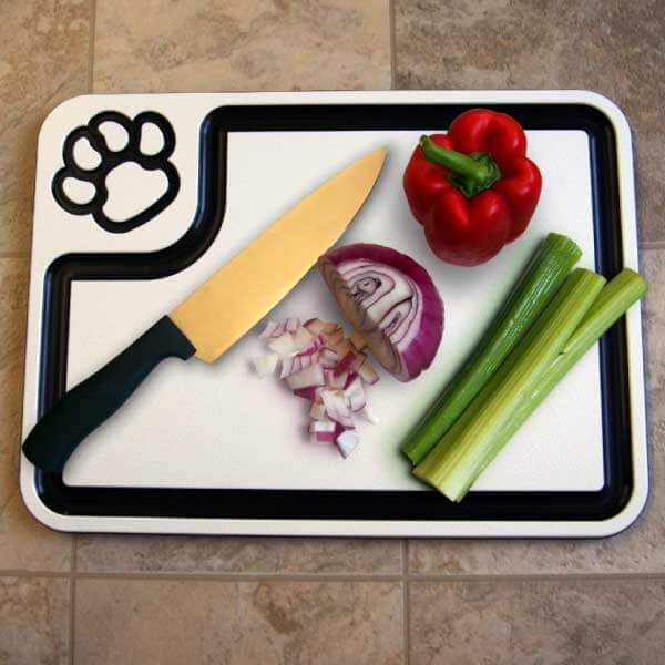 White paw-print cutting board in use.